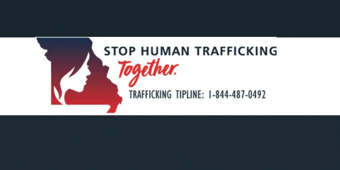 logo image says stop human trafficking together. Bears a toll free number to be used to report suspected trafficking  - toll free - 1-844-487-0492
