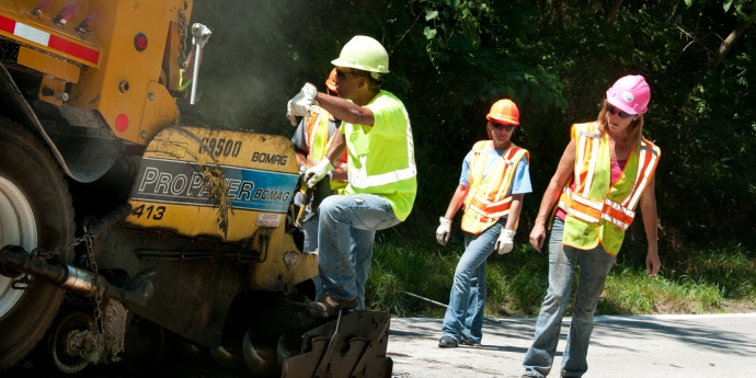 diverse workers working on road