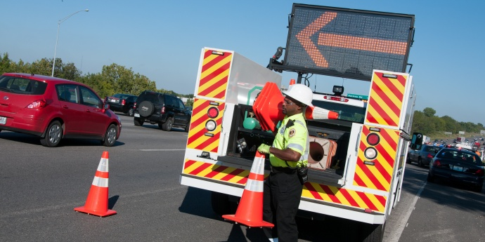 an incident response worker sets cones