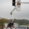 Sign crew installing signage and signals