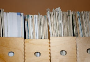 a shelf of archived papers