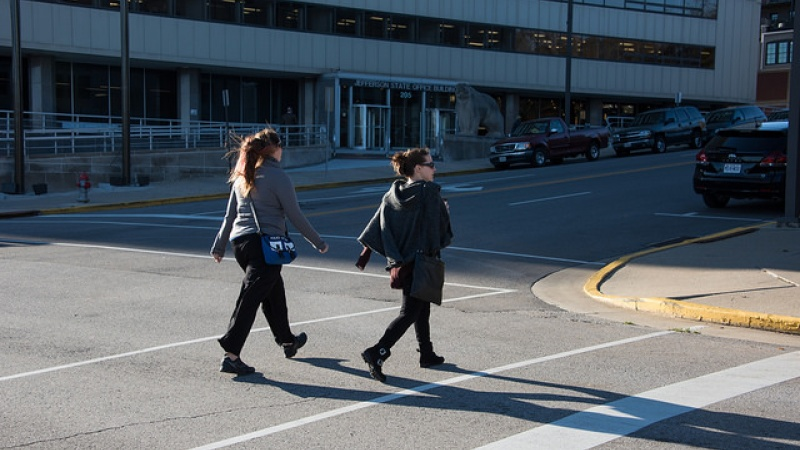 Pair of women properly crossing street