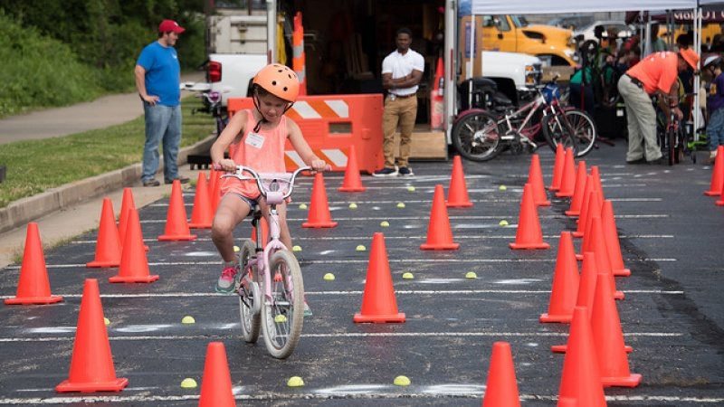 Girl safely navigating bicycle obstacle course