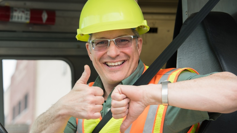 a modot employee flashes the buckle up phone down thumbs