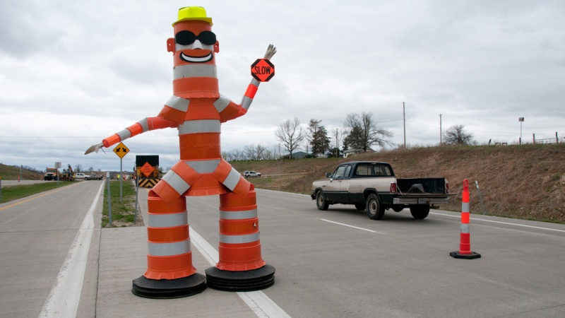 Barrel Bob telling drivers to slow down near a work zone