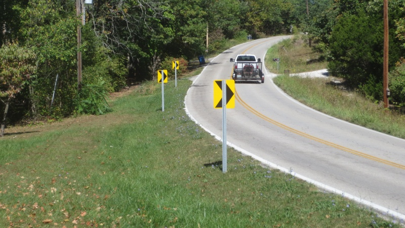 A photo of the florescent curve sign.