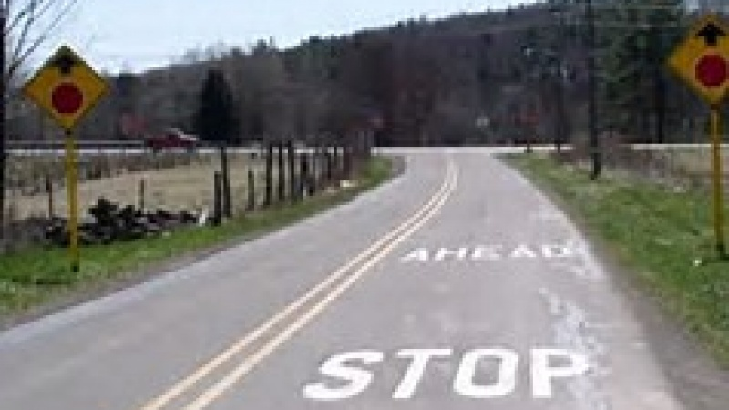 Photo of stop ahead pavement markings