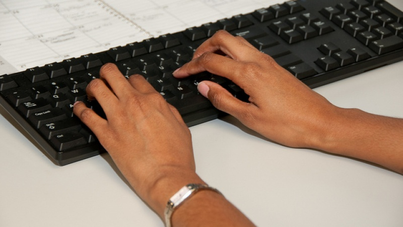 Employee typing at desk