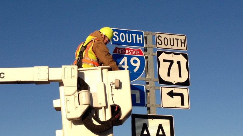 Installation of new I-49 sign in Newton County 2012