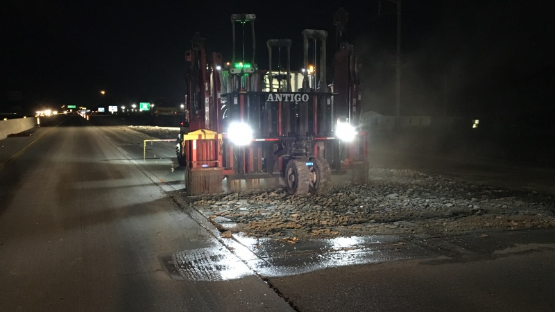 Large machines break up the old Route 65 pavement