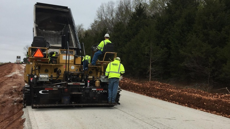 Crews laying base rock for new lanes