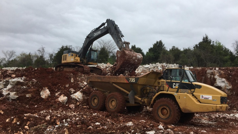 Crews moving rock and dirt, making way for new highway lanes