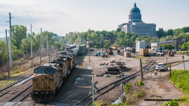 Trains with Missouri Capitol building in background