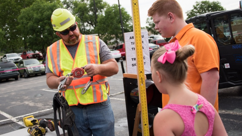 MoDOT employee discussing tools with members of the public