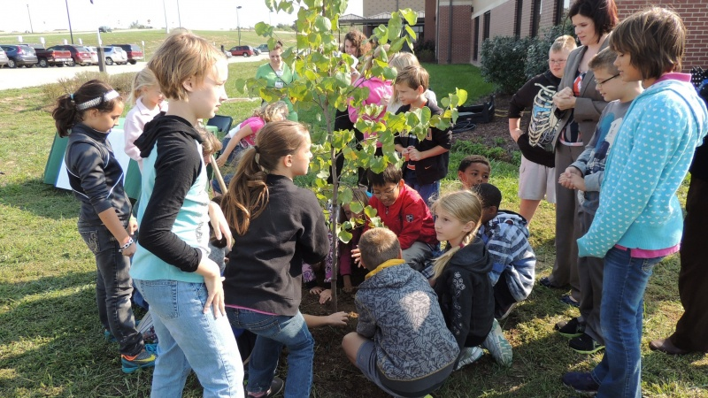 MoDOT crews discuss trees with a group of children